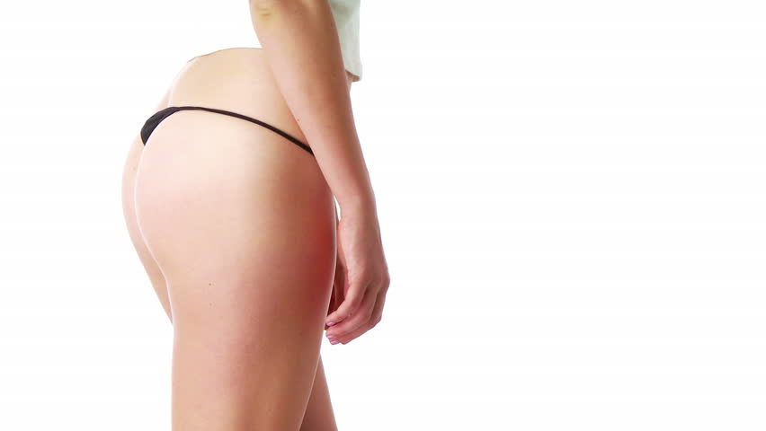 Young woman in sexy black underwear pulling up jeans - HD stock video clip