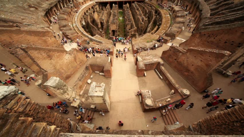 Walkway to entrance to Colosseum arena, some tourists stand where, shown from above - HD stock footage clip