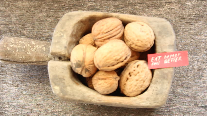 Eat Better Feel Better - inscription on the label and and walnuts. Healthy lifestyle concept. Toned video.