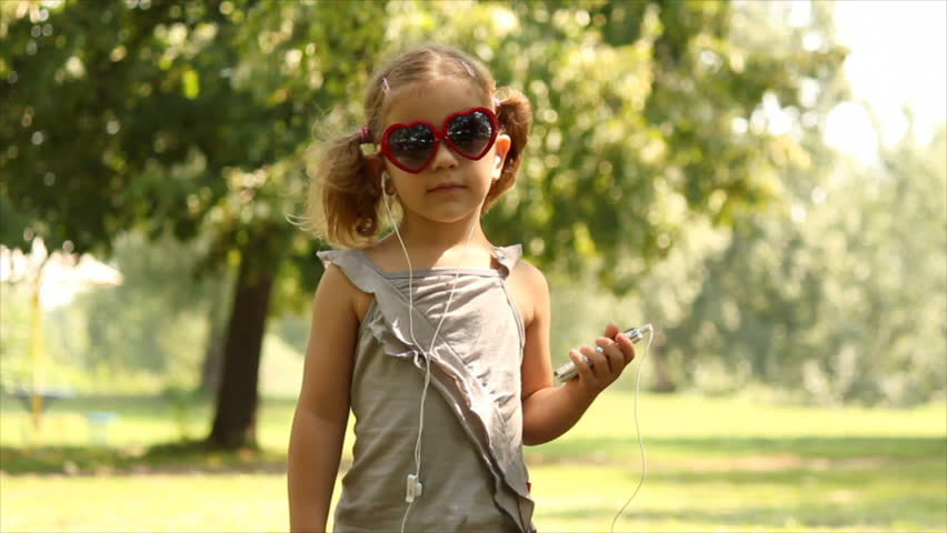 little girl listening music and dancing - HD stock video clip