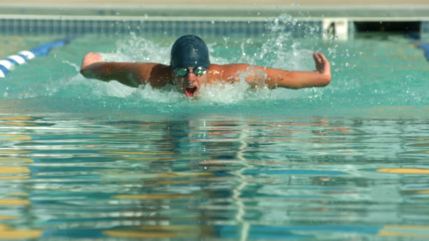 Cinemagraph - Swimmer doing freestyle stroke. Looping Motion Photo.
