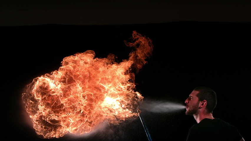 Cinemagraph - Firebreather, slow motion. Looping Motion Photo.