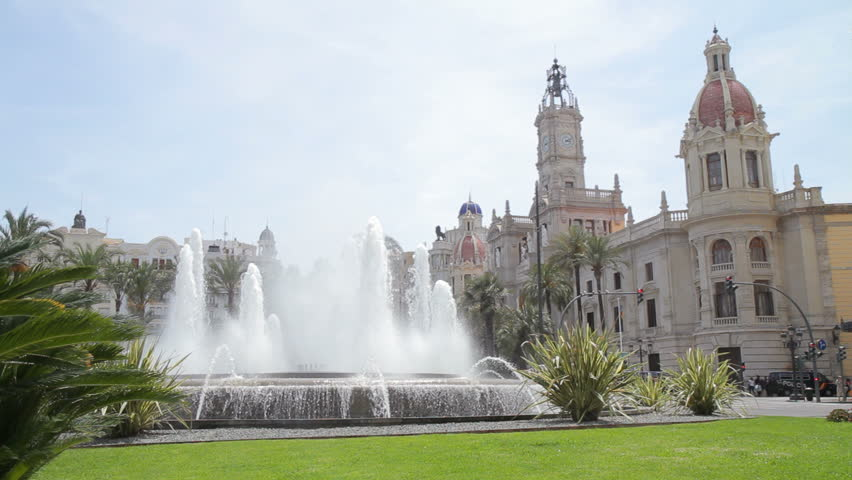 Valencia town hall square in the afternoon,  featuring a large fountain and the town hall in the right background (Spain, 06/2011; 1080p, HDSLR).  - HD stock video clip