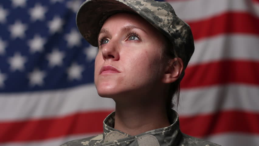 Female soldier in front of US flag, looking up - HD stock footage clip