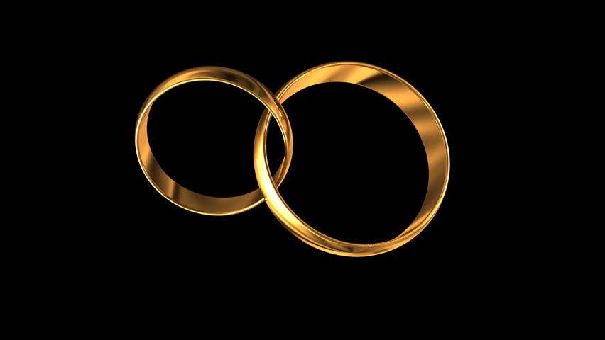 wedding rings on a black background with the alpha channel
