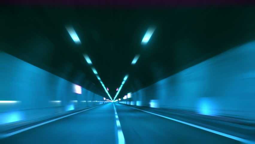 Driving through tunnel, abstract with motion blur and glow.