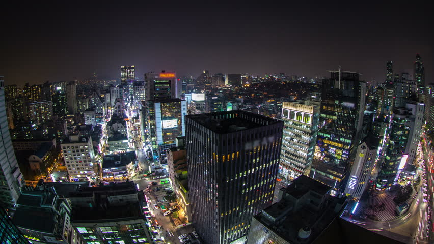 Time lapse of people, traffic and architecture in downtown Gangnam. Seoul Korea.