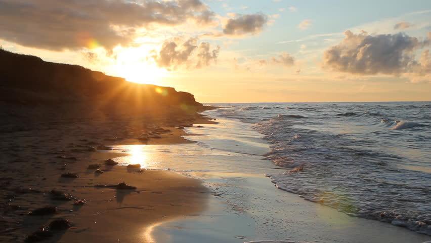 Golden beach sunset. Golden sunset on a beach. Summer in Prince Edward Island, Canada.
