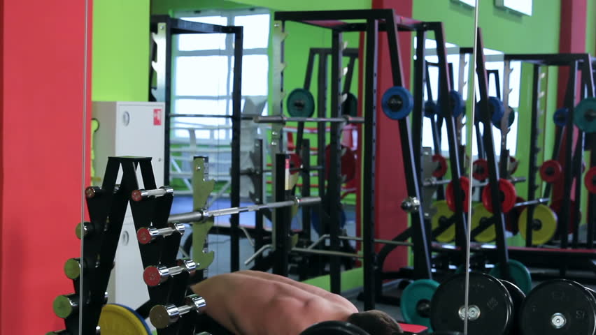 Workout for young bodybuilder. Man doing exercise for biceps with dumbbells