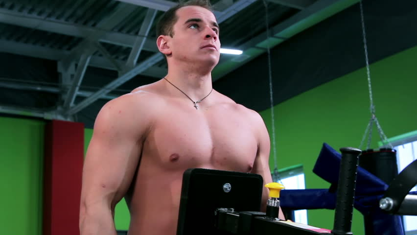 Workout for young bodybuilder. Exercises for arms and back and chest with exercise equipment