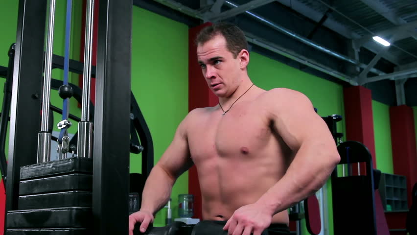 Workout for young bodybuilder. Exercises for arms and back and chest with exercise equipment closeup