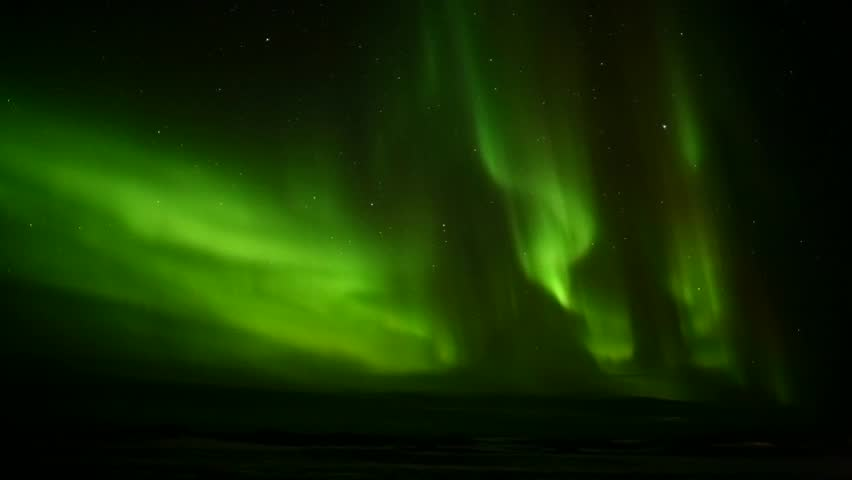 Green Northern Lights dancing over the sea