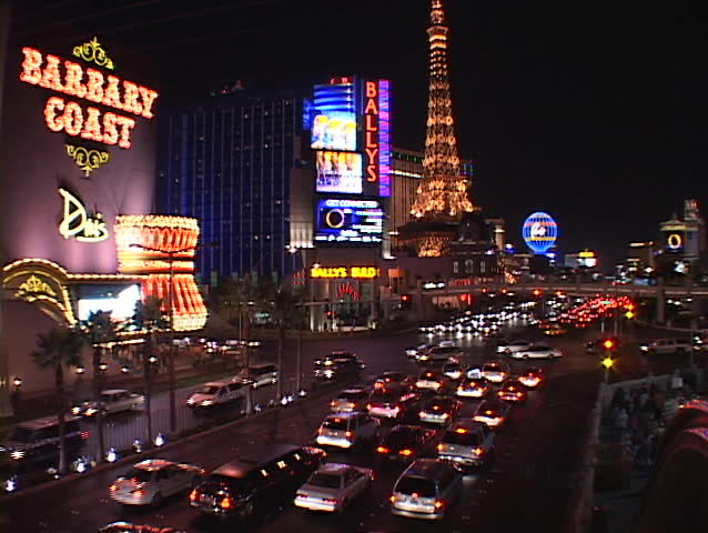 LAS VEGAS, NV - CIRCA 2010: Traffic drives past the hotels and casinos on the Las Vegas strip circa 2010 in Las Vegas, NV. | Shutterstock HD Video #1377241