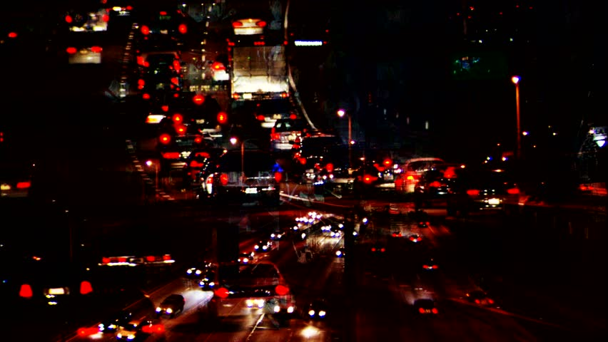 Freeway traffic at night motion graphic - HD stock video clip
