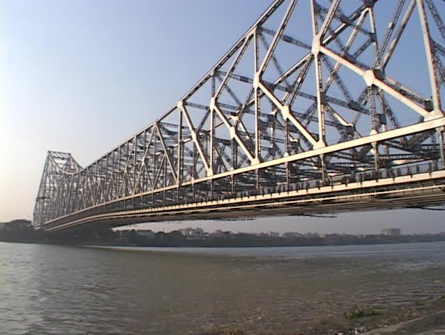 Howrah Bridge spans a river in Calcutta, India. - SD stock footage clip