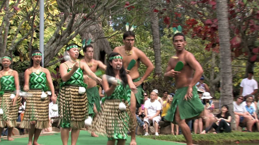 Polynesian Cultural Center, Oahu, Hawaii. Students from Brigham Young University putting on shows and demonstrations. Boat or canoe representing New Zealand culture with dancers. Editorial use.  - HD stock footage clip