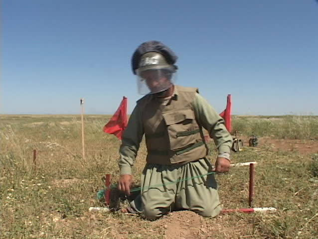 IRAQ - CIRCA 2003: A land mine removal expert prepares to remove a land mine CIRCA 2003 in Iraq.