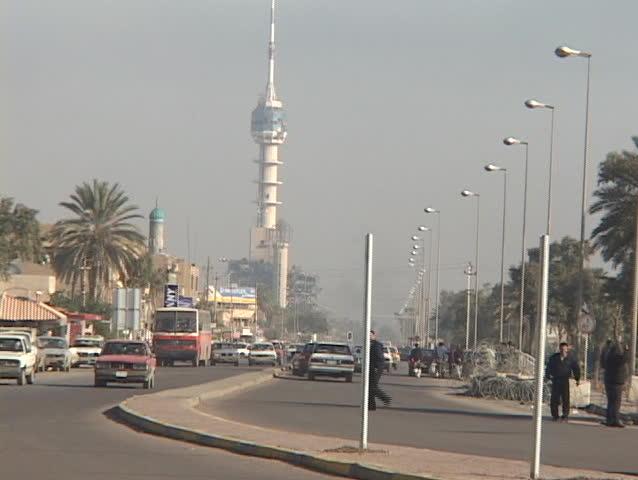BAGHDAD - CIRCA 2003: Traffic flows on a busy street circa 2003 in Baghdad, Iraq.