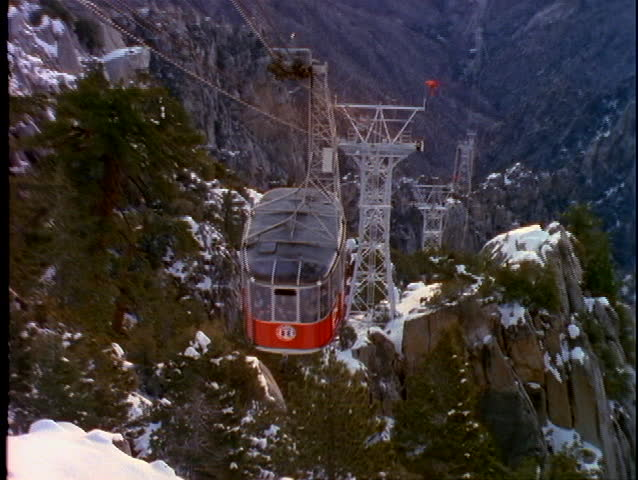 PALM SPRINGS, CA - CIRCA 1997: A ski tram moves up the side of a steep mountain circa 1997 in Palm Springs, CA.