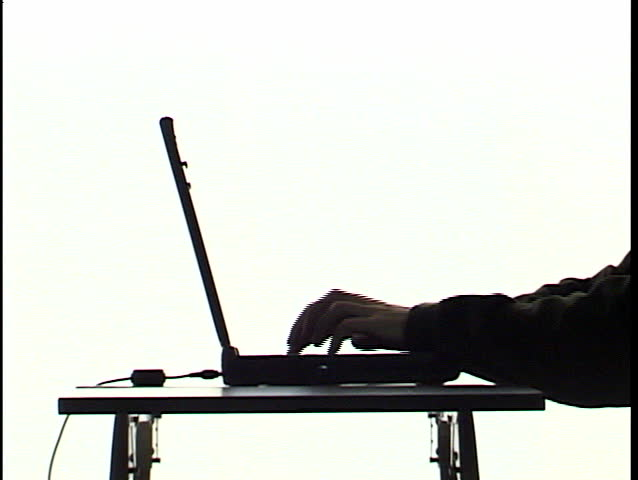 typing on laptop in silhouette 1 - SD stock footage clip