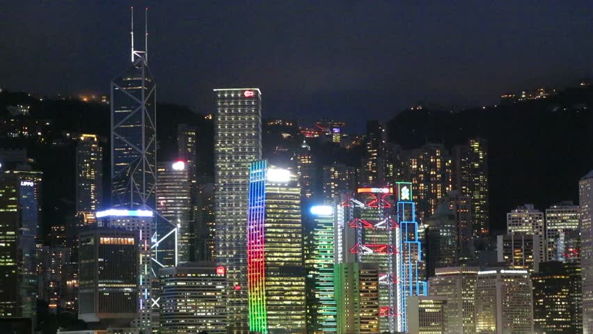 Hong Kong, China – August 13, 2015: Light Display and skyscrapers in Victoria Harbour of Hong Kong. Boats are in the harbour.