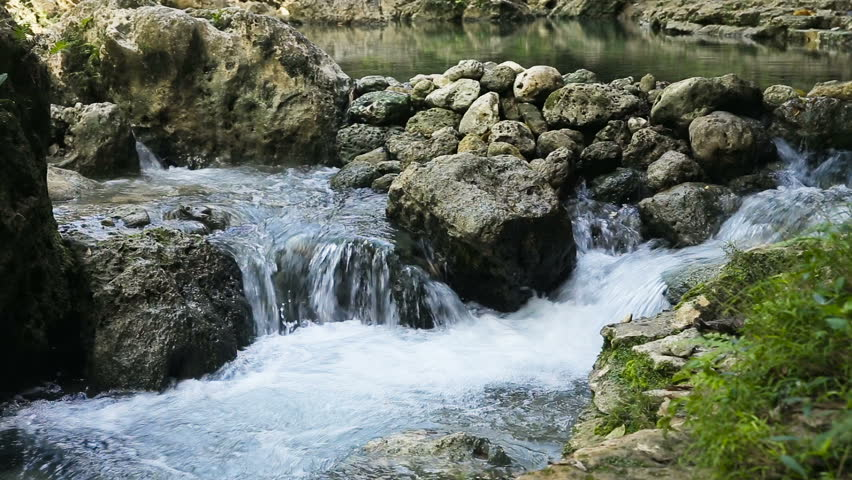 stones and mountain river with small waterfall.Stones in the flowing river.River Mountain threshold. - HD stock video clip