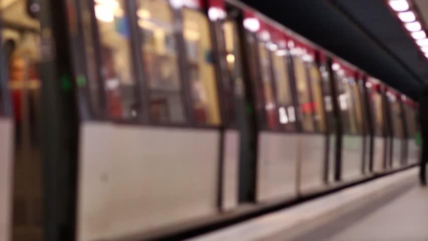 Out of focus shot of a metro train while in station. - HD stock video clip