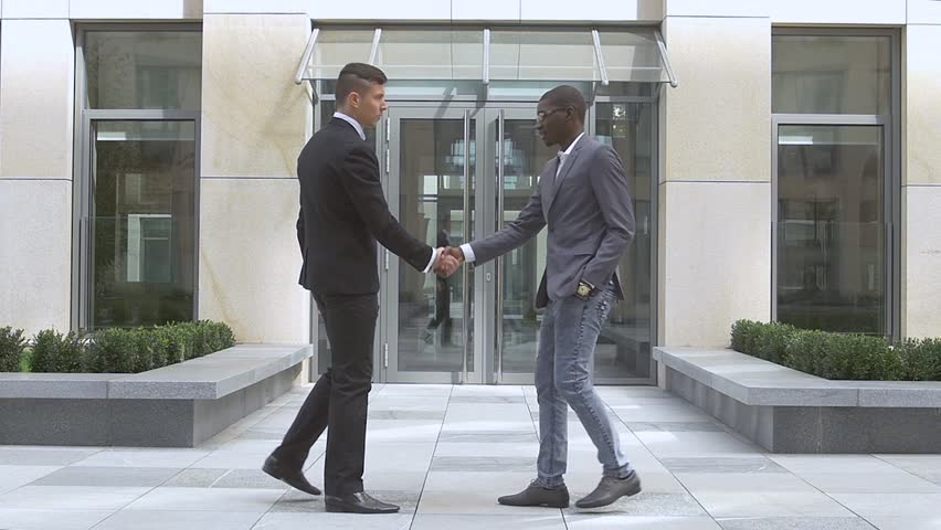 businessmen shaking hands,success multiracial Businesspeople, slow motion - HD stock video clip
