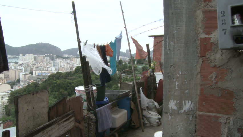 Oct 2008 - Rio De Janeiro, Brazil: static shot of cityscape residential favela hanging laundry for air drying in Rio De Janeiro, Brazil with view of Guanabara Bay islands | Shutterstock HD Video #14326729