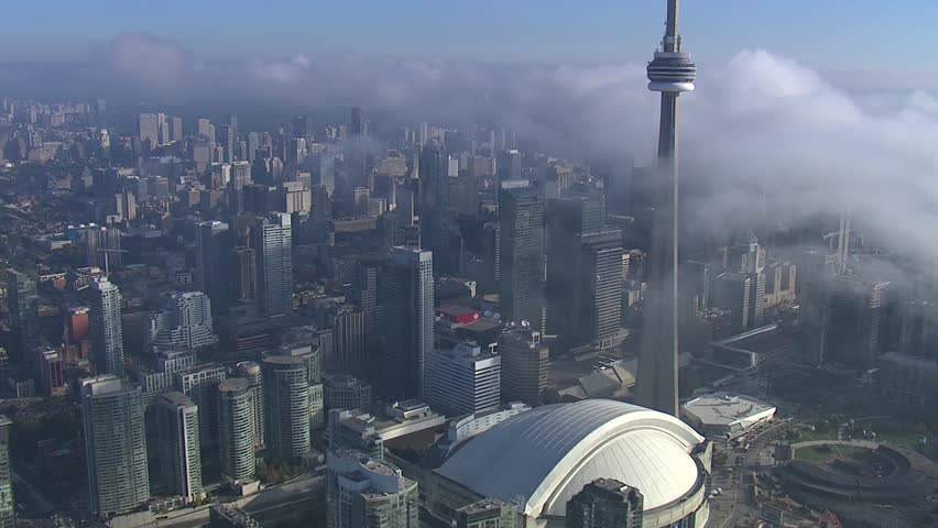 The iconic CN Tower dominates the skyline on a misty early morning
