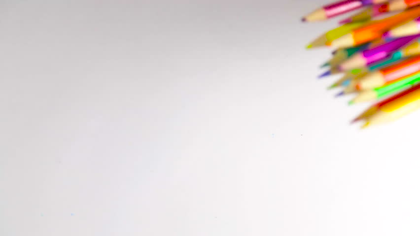 Colored pencils on white table dropped | Shutterstock HD Video #14348356