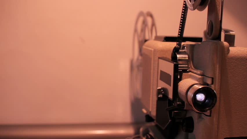 Retro film projector 8mm dolly motion spool rotating | Shutterstock HD Video #14359903