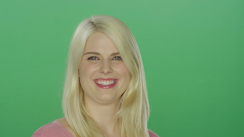 video clip stock fooe beautiful blonde woman flipping hair laughing green screen studio background