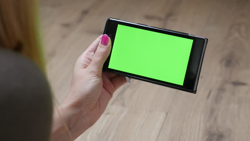 Modern female holding in hand smart phone with green screen display chroma key 4K 2160p 30fps UltraHD footage - Business woman with greenscreen tablet relaxing 4K 3840X2160 UHD video | Shutterstock HD Video #14390836