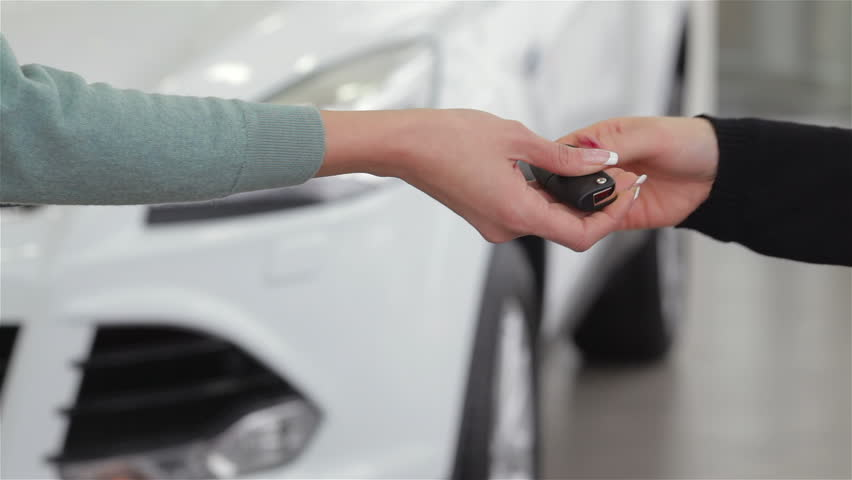 Saleswoman giving car key - HD stock video clip