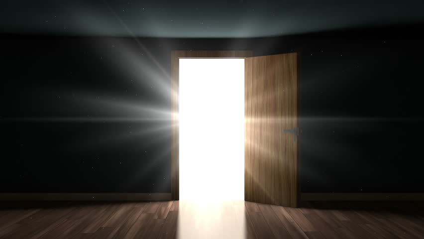 4K Light and particles in a room through the opening door. - 4K stock video clip
