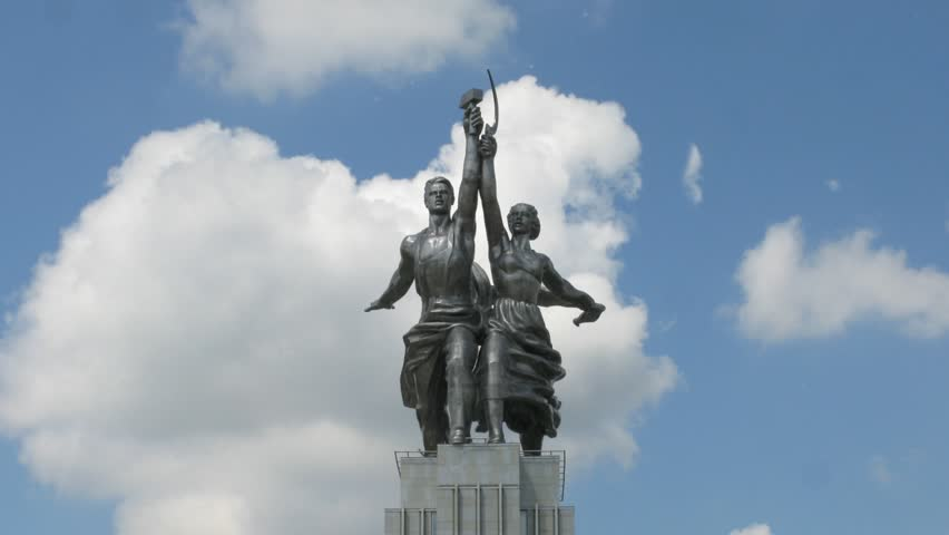 Worker and Kolkhoz Woman monument in front of passing clouds, turning, time lapse - HD stock footage clip