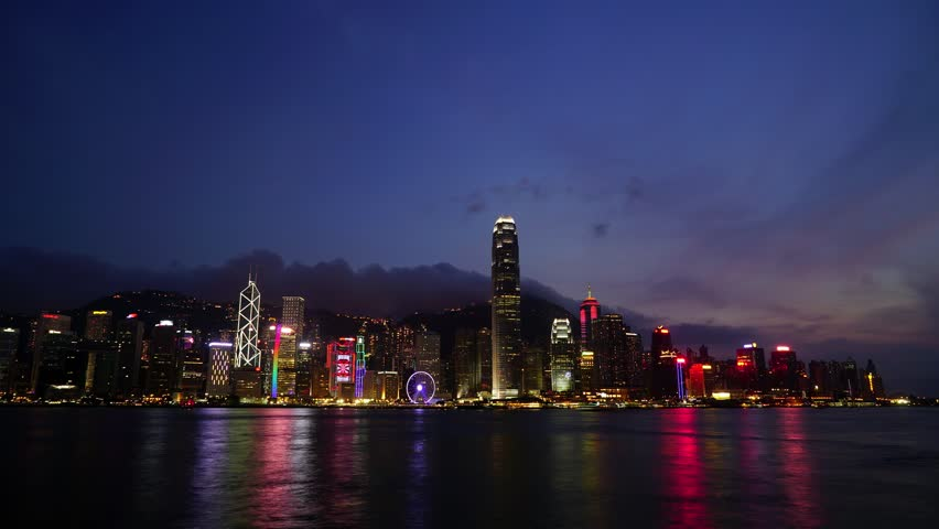 Hong Kong, Victoria Harbour seen from a rooftop in Kowloon. From end of day to sunset. Clouds and boats cross the bay. | Shutterstock HD Video #14510680