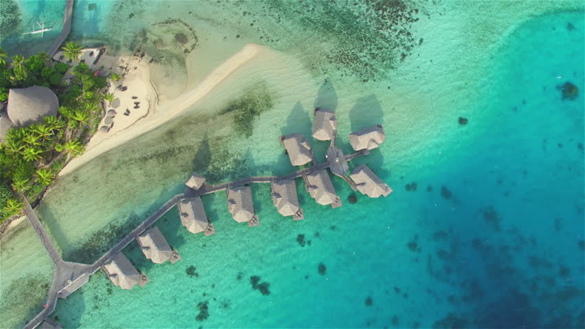 AERIAL: Flying above luxury island resort hotel with secluded deluxe overwater bungalows and beachfront villas in Bora Bora picture-perfect turquoise-blue lagoon and tropical white sandy beaches | Shutterstock HD Video #14510950