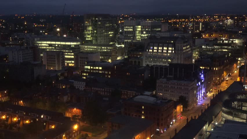 MANCHESTER - ENGLAND, MAY 28, 2015, 4K Aerial view of downtown by night with traffic car on busy avenue