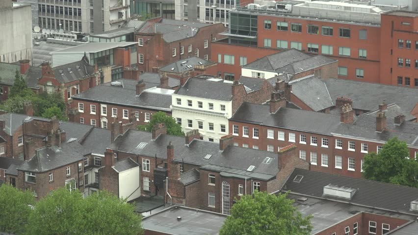 MANCHESTER - ENGLAND, MAY 28, 2015, 4K Tilt down of residential house panorama with red brick by day
