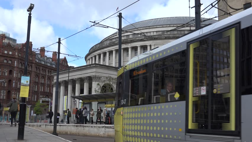 MANCHESTER - ENGLAND, MAY 28, 2015, 4K Public library building and tramway station by day