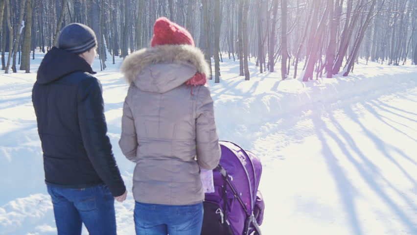 Happy young family walking in the park in winter | Shutterstock HD Video #14538139