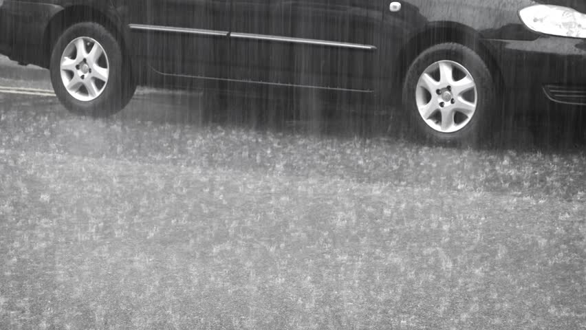 Looped video. The car under heavy rain. UHD video - 4K stock footage clip