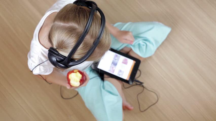 Little girl on the floor in the room using tablet   Shutterstock HD Video #14570287