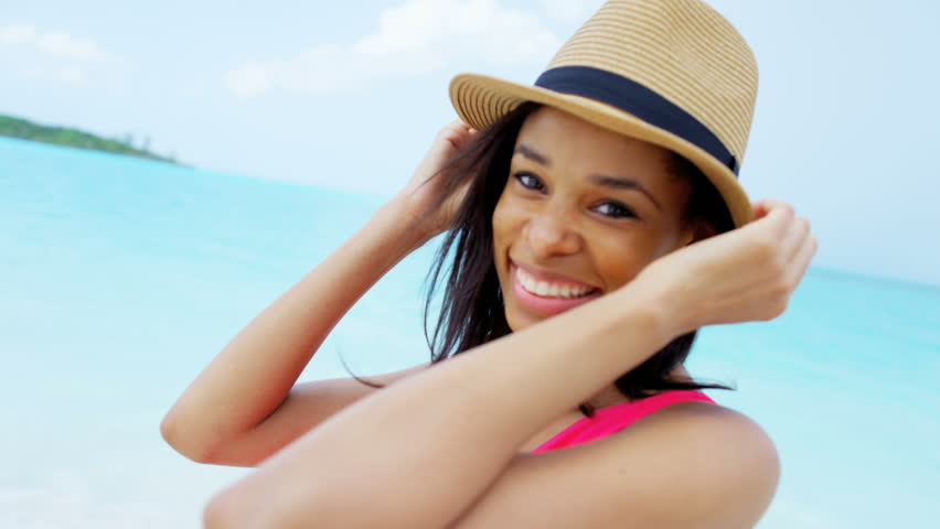 Portrait ethnic African American young female beach fashion sun hat selfie smile dream success tourism resort travel RED DRAGON | Shutterstock HD Video #14581942