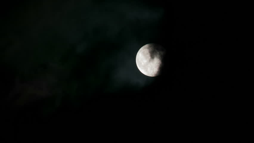 full moon night, through the disk that are flying clouds - HD stock video clip