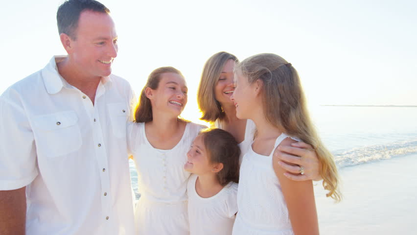 Portrait of a smiling Caucasian family wearing white clothes on beach | Shutterstock HD Video #14609167