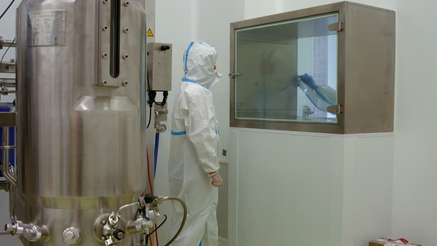 Scientist in protective suits working on vat in high quality 4k format | Shutterstock HD Video #14613073