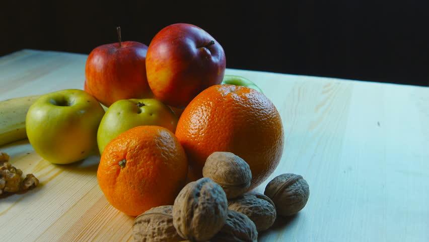Various fruits turning around  - 4K stock footage clip